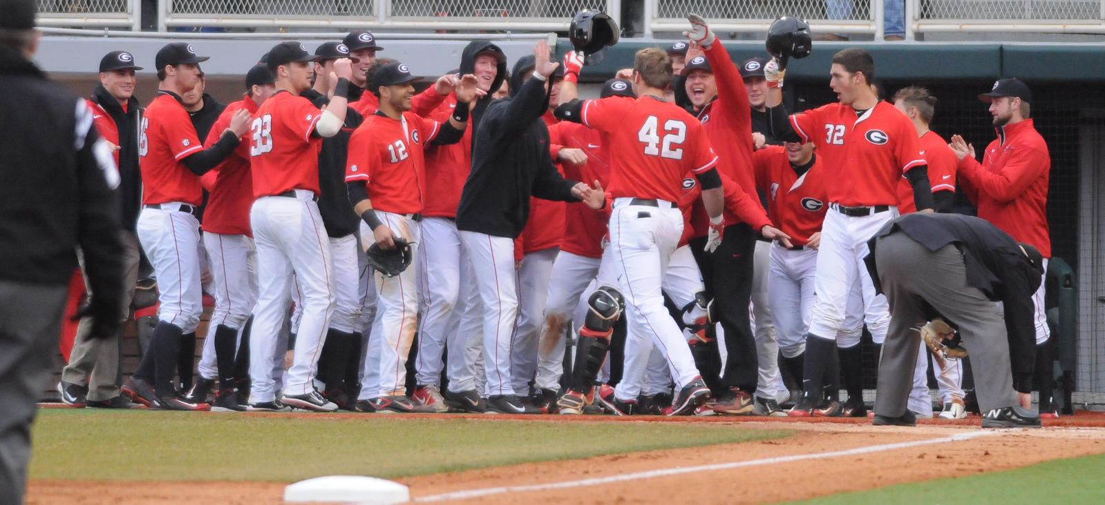 Georgia players celebrate after Georgia's Trevor Kieboom (42) hit a home run during a men's NCAA baseball game between the University of Georgia and Florida State University on Saturday, February 21, 2015 in Athens, Ga. (Photo by Sean Taylor)