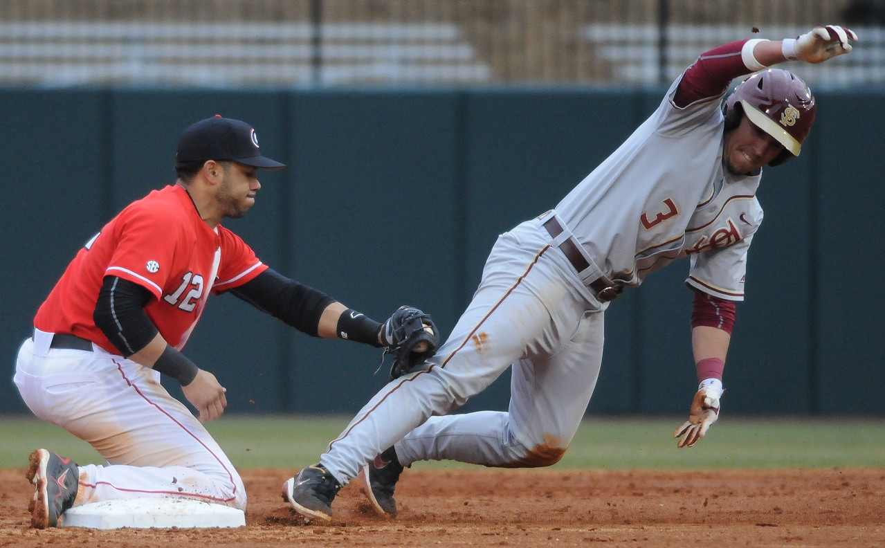 Georgia's Mike Bell (12) tags out Florida State's Darren Miller during a men's NCAA baseball game between the University of Georgia and Florida State University on Saturday, February 21, 2015 in Athens, Ga. (Photo by Sean Taylor)