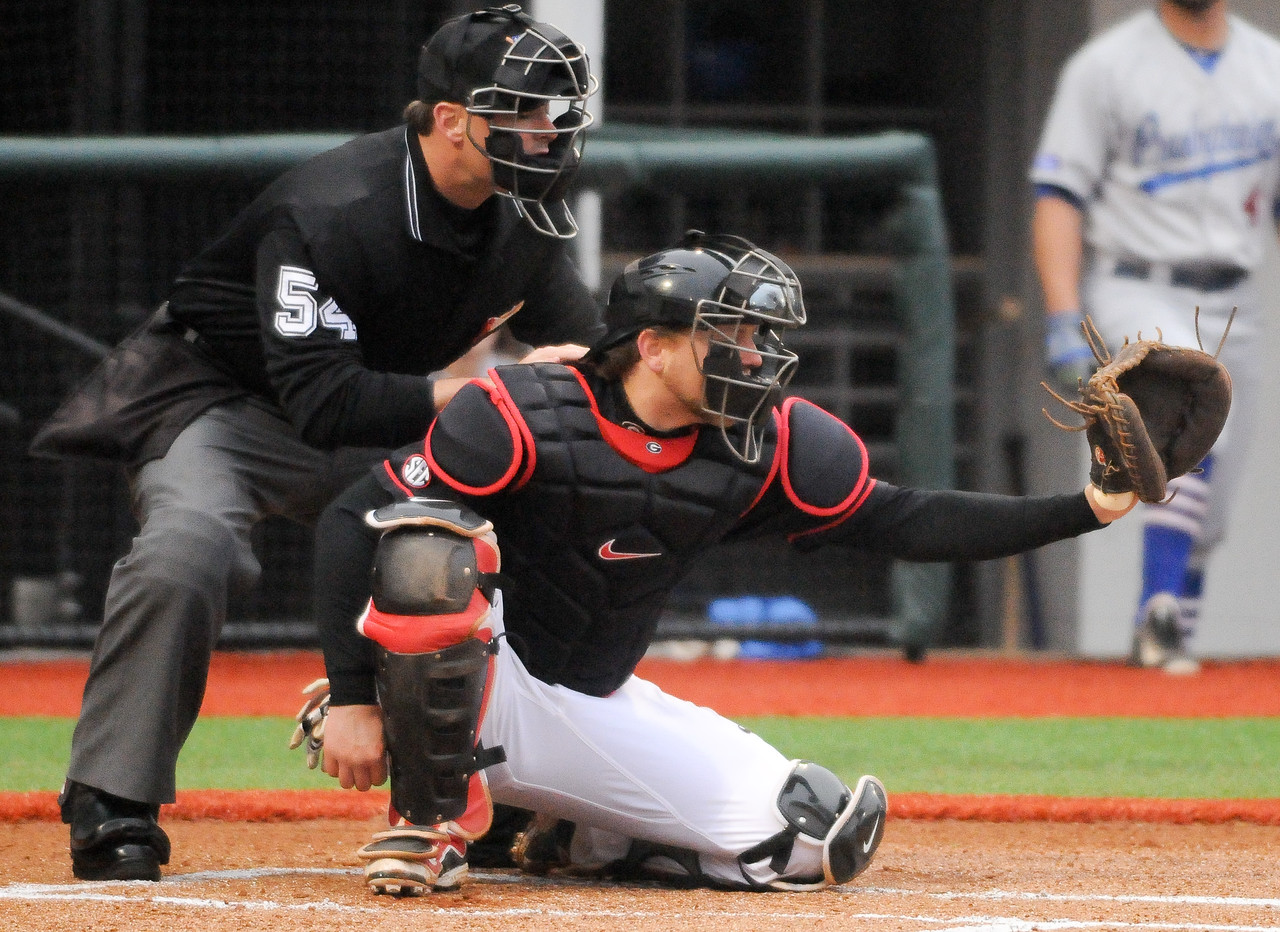 Georgia's Brandon Stephens (5) prepares to receive a pitch from Georgia's Sean McLaughlin (3) during a men's NCAA baseball game between the University of Georgia and Presbyterian College on Tuesday, February 24, 2015 in Athens, Ga. (Photo by Sean Taylor)