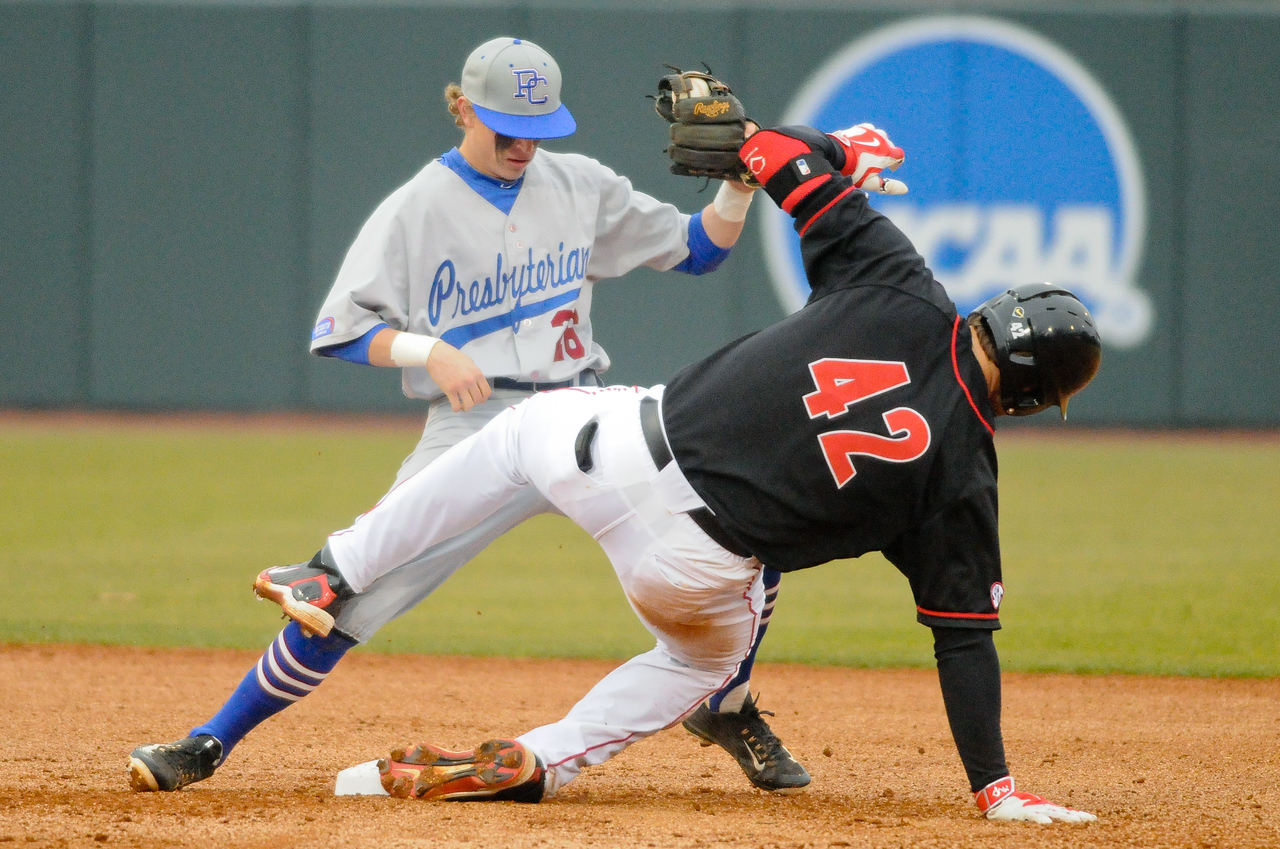 Georgia's Trevor Kieboom (42) slides safe into second base during a men's NCAA baseball game between the University of Georgia and Presbyterian College on Tuesday, February 24, 2015 in Athens, Ga. (Photo by Sean Taylor)