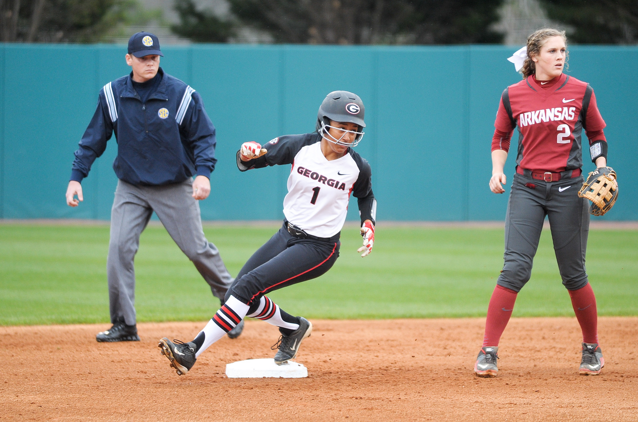 Georgia's Cortni Emanuel (1) looks to home plate after stealing second base during an NCAA softball game between the University of Georgia and the University of Arkansas.