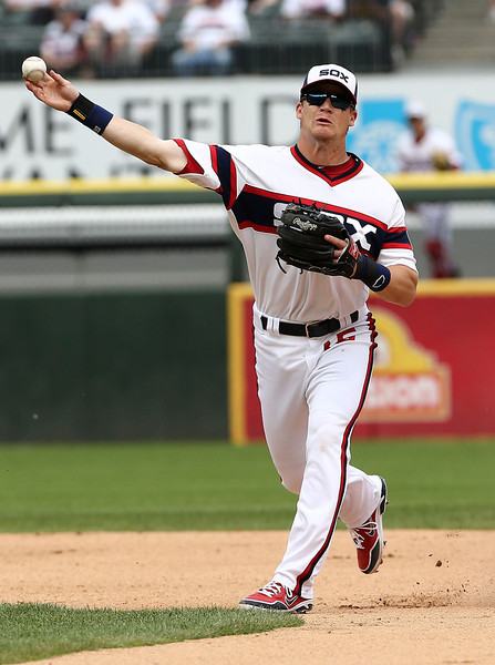 Chicago White Sox second baseman Gordon Beckham relays to first during double play attempt in the seventh inning. Oakland Athletic runner is John Jascoa as the White Sox beat the Athletics 4-2 in a baseball game in Chicago on Sunday, June 9, 2013. (AP Photo/Charles Cherney)