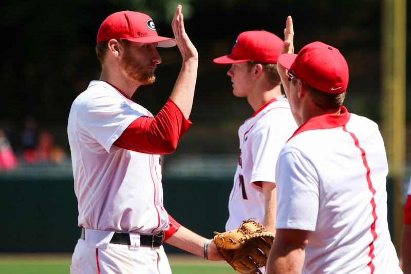 Georgia pitcher Heath Holder (28) high fives his teammates during the NCAA baseball game between Georgia and Ole Miss at Foley Field on Sunday, May 8, 2016 in Athens, Ga. (Photo by Emily Selby)
