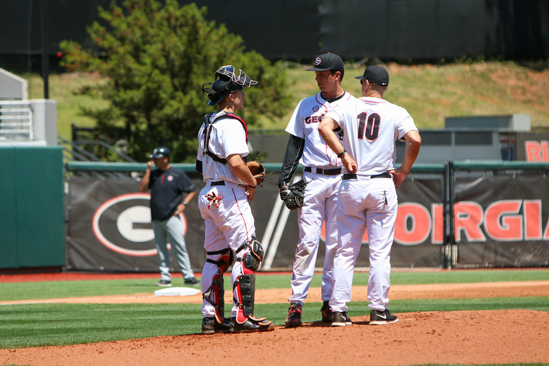 Georgia catcher Michael Curry (13) talks with Georgia pitcher Bo Tucker (25) and Head coach Scott Stricklin during the NCAA baseball game (Photo by Emily Selby)