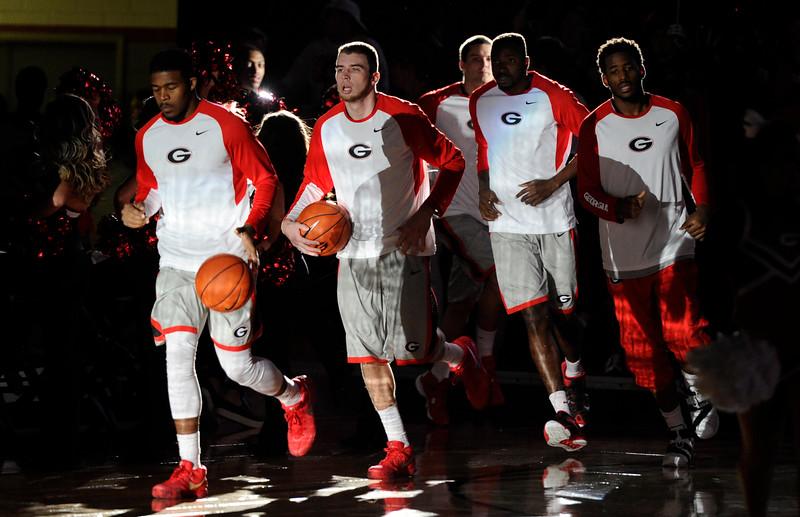 Georgia takes the floor during the Bulldogs' basketball game against the Arkansas Razorbacks at Stegeman Coliseum on Saturday, January 23,2016 in Athens Georgia (Photo by John Kelley)