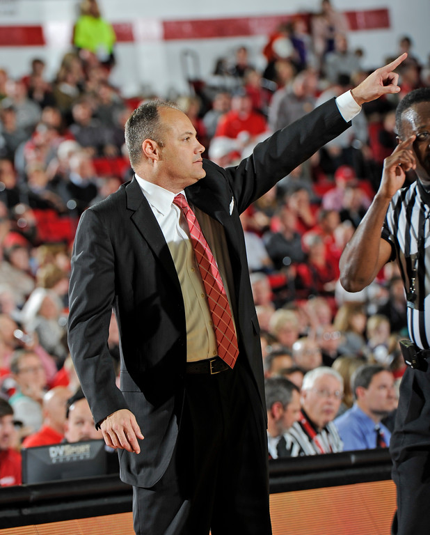 Georgia head coach Mark Fox makes the call during the Bulldogs' game against the Clemson Tigers at Stegeman Coliseum on Tuesday, Dec. 22, 2015 in Athens, Ga. (Photo by John Kelley)