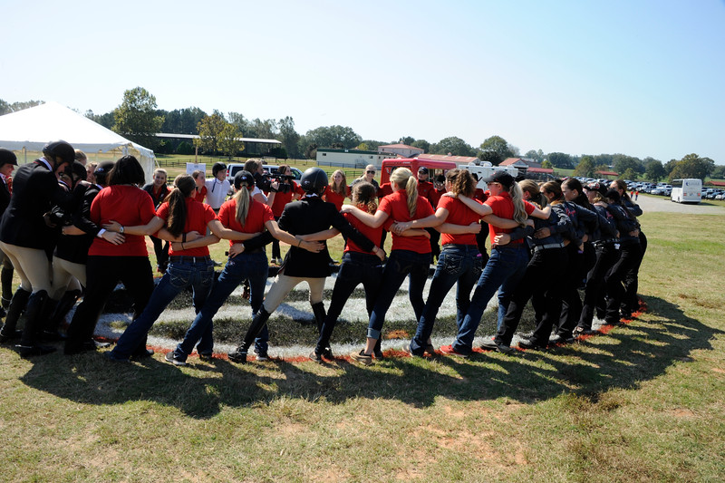Georgia's team starts their chant during the Bulldogs' meet with the Oklahoma State Cowgirls at the UGA Equestrian Complex on Friday, Oct. 16, 2015 in Bishop, Ga. (Photo by John Kelley)