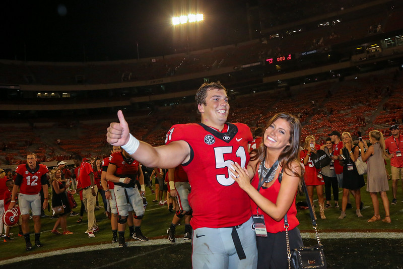 Jake's Proposal to Peyton Thomas After the Game (Photo by Blane Marable Photography)