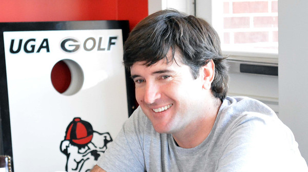 Two-time Masters champion Bubba Watson is all smiles while chatting with members of the Georgia golf team during his visit to Athens, Ga., on Monday, April 21, 2014. (Photo by Steven Colquitt)