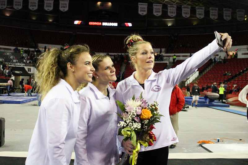 Seniors Mary Beth Box, Brandie Jay, and Brittany Rogers take a selfie after senior night during an NCAA gymnastics meet (Photo by Emily Selby)