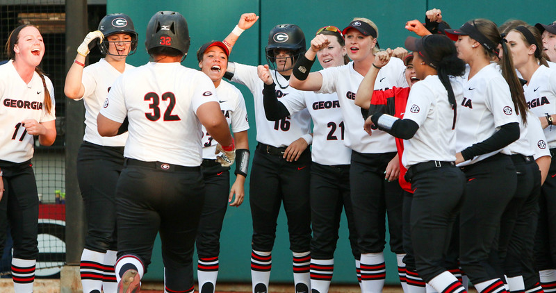 The softball team cheers as Georgia infielder Tina Iosefa (32) runs to home plate after a home run during an NCAA softball game (Photo by Emily Selby)