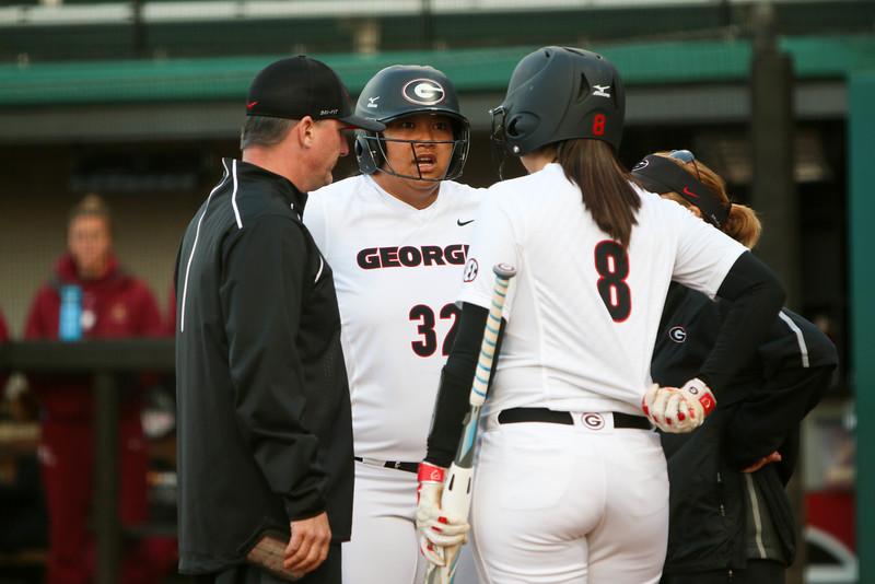 Georgia infielder Tina Iosefa (32) talks to Georgia infielder Alyssa DiCarlo (8) during an NCAA softball game (Photo by Emily Selby)