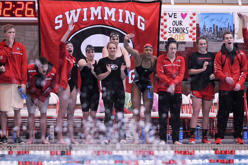 Georgia swimmers cheer on their teammates during an NCAA swim meet between the University of Georgia and Emory University on Saturday, January 31, 2015. (Photo by Sean Taylor)