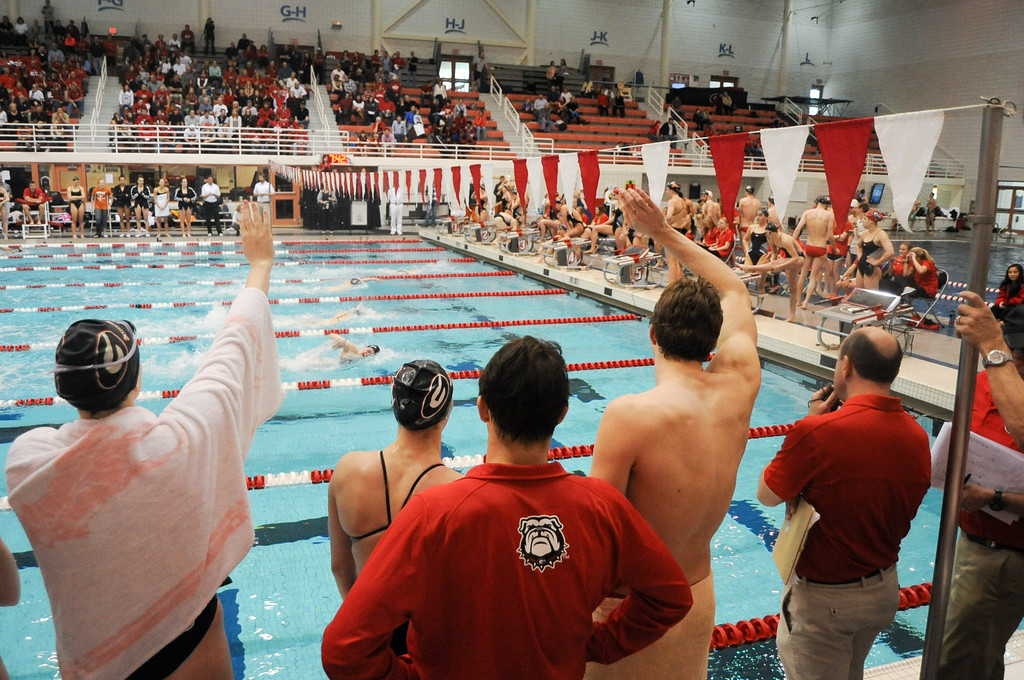 Georgia swimmers cheer during an NCAA swimming meet between the University of Georgia Bulldogs and the University of Texas Longhorns on Saturday, January 10, 2015 in Athens, Ga. (Photo by Sean Taylor)