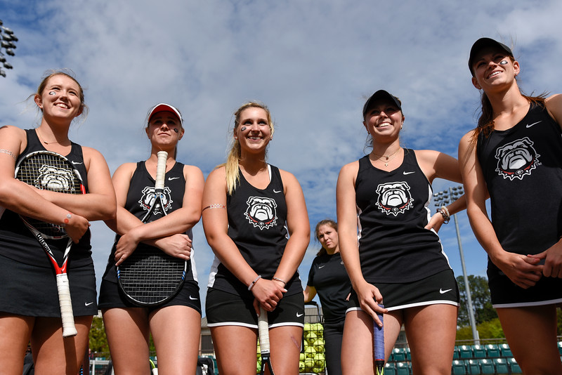 Members of the Georgia women's tennis team warm-up before their NCAA match against the University of Florida at the Dan Magill Tennis Complex on Friday, April 15, 2016, in Athens, Georgia. (Photo by David Barnes)