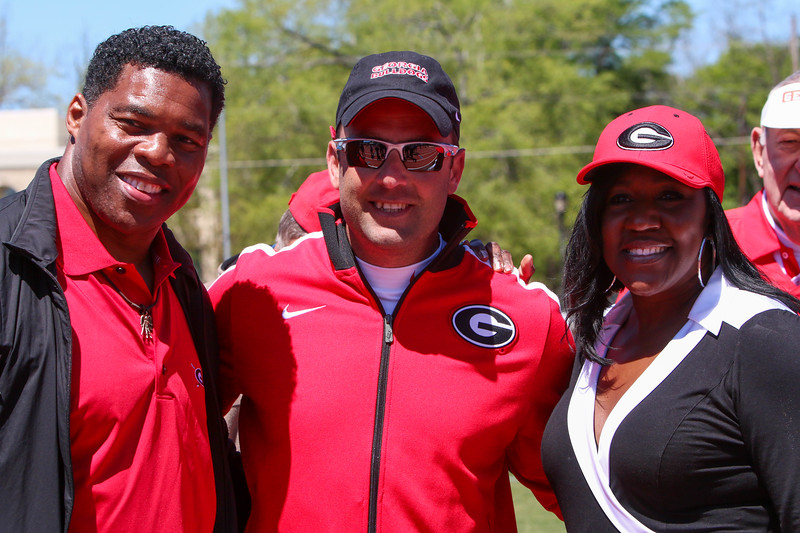 Georgia head coach Petros Kyprianou poses for a photo with Herschel Walker and Gwen Torrence during the 2016 Spec Towns Track Invitational on Saturday, April 9, 2016, in Athens, Ga. (Photo by Emily Selby)